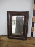 wall mirror in a dark wooden frame