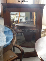 Mirror in a wooden decorated frame