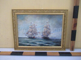 An image of two historic sailboats in a gold frame
