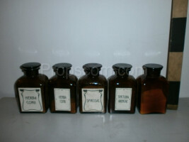 Bottles with ground glass square dark glass