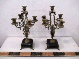 Forged four-branched candlesticks