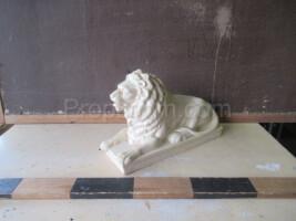Porcelain lion statuette